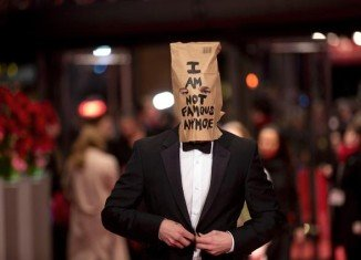 Shia LaBeouf appeared on the Berlin Film Festival red carpet wearing a paper bag on his head