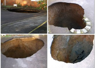 The 30ft deep sinkhole has opened up on the driveway of a house in High Wycombe