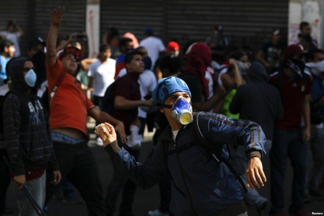 The number of deaths which can be connected to two weeks of anti-government protests in Venezuela has risen above 50, President Nicolas Maduro has said