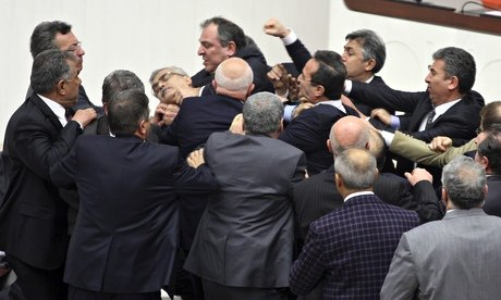 Turkish lawmakers have approved controversial plans to reform the country's top judicial body, amid a brawl which left one opposition legislator with a broken nose