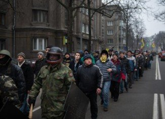 Ukrainian protesters are leaving city hall in Kiev, the symbolic centre of prolonged anti-government demonstrations