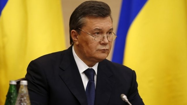 Viktor Yanukovych has made his first public appearance since being removed from office at a news conference in Russia