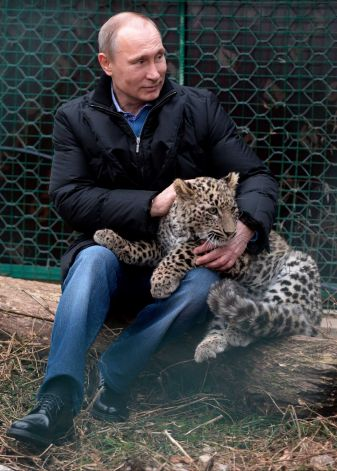 Vladimir Putin has taken senior Olympics officials on a tour of a Persian leopard sanctuary ahead of the Winter Games in Sochi