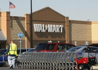 Wal-Mart's net income for Q1 2014 fell to $4.4 billion from $5.6 billion a year earlier