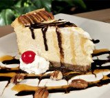 White Chocolate Cheesecake with White Chocolate Brandy Sauce