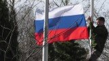 Activists put Russian flag at the Sevastapol navy base