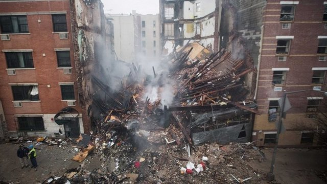 East Harlem explosion destroyed two buildings and smashed nearby windows photo
