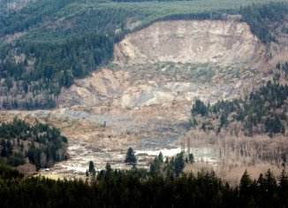 Eight bodies have been recovered so far after the 177ft deep wall of mud swept near the town of Oso