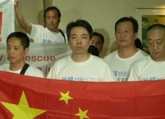 Families of Chinese passengers from the missing flight MH370 have vented their anger at Malaysian government officials