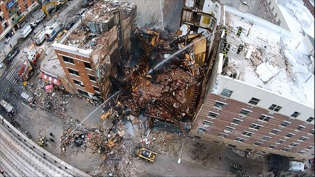 Firefighters are trying to find further victims with the death toll expected to rise at the Harlem explosion site photo
