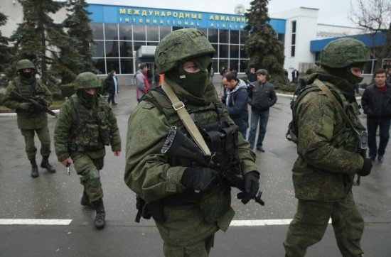 Heavily armed groups continue to occupy key sites in Crimea, including airports and communications hubs