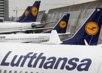 Lufthansa pilots have voted to strike in a long-running dispute over pay and working conditions