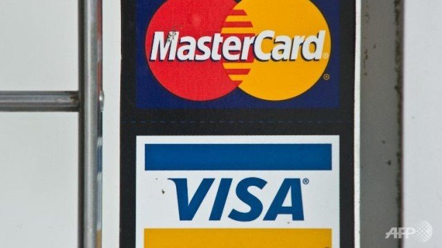 MasterCard and Visa have decided to block credit card services to some Russian bank customers as a result of US sanctions