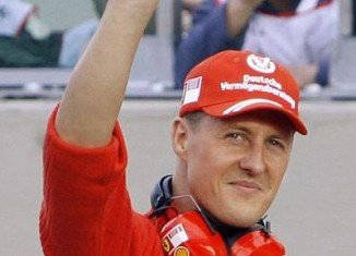 "Michael Schumacher has been showing ""small, encouraging signs"" in his fight for recovery"