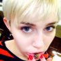 Miley Cyrus shows off new sad cat Emoji lip tattoo. Is it fake or permanent?