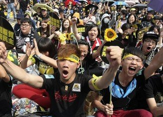 More than 100,000 people have taken to the streets of capital Taipei, to protest against a controversial trade agreement with China