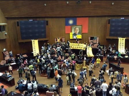 Taiwan's parliament has been occupied by hundreds of students and activists protesting against a trade deal with China and defying police efforts to evict them