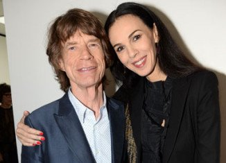 The Rolling Stones have cancelled the first date of their On Fire tour in Australia following the death of Mick Jagger's girlfriend L'Wren Scott