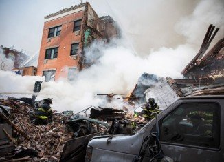 Three people have died and nine are missing after a gas leak sparked an explosion which leveled two buildings in East Harlem