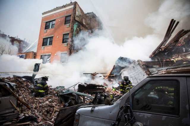 Three people have died and nine are missing after a gas leak sparked an explosion which leveled two buildings in East Harlem 640x426 photo