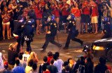 Tucson police shot pepper spray at several hundred fans who took to the streets after Arizona's overtime loss