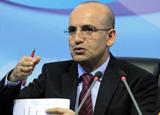 Turkish Finance Minister Mehmet Simsek defends his government's decision to ban Twitter, accusing the website of failing to comply with court orders