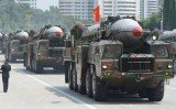 Two medium-range ballistic missiles have been test-fired by North Korea, just hours after the US, South Korea and Japan met in the Netherlands for talks