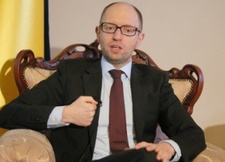 Ukraine's interim Prime Minister Arseniy Yatsenyuk and the EU signed the deal in Brussels