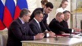 Vladimir Putin and Crimean leaders signs treaty to incorporate the peninsula into Russia