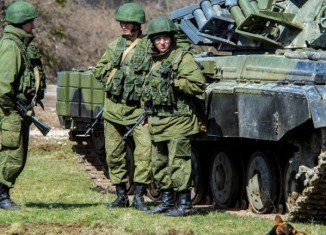 "Vladimir Putin has ordered a ""partial withdrawal"" of troops from the border with Ukraine"