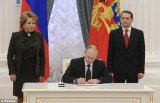 Vladimir Putin has signed a law formalizing the takeover of Crimea from Ukraine