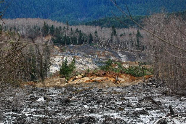Washington authorities have found six more bodies after Saturday's huge landslide