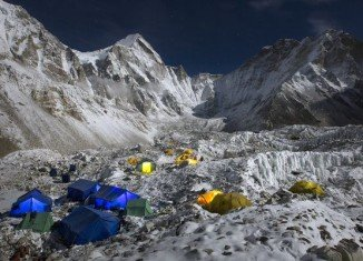About half of expedition teams at Everest base camp are descending amid uncertainty over this year's climbing season