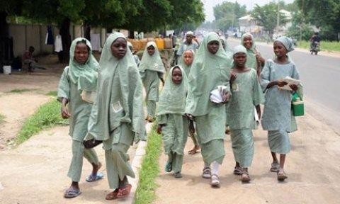 Boko Haram gunmen abducted around 100 schoolgirls in an attack on a school in north-east Nigeria