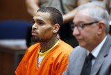 Chris Brown and his bodyguard Christopher Hollosy were arrested in October after a man accused them of punching him outside a Washington hotel