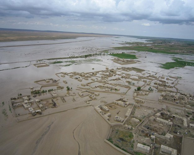 Fifty-eight people have been killed and hundreds of villagers left stranded in devastating flash floods in northern Afghanistan