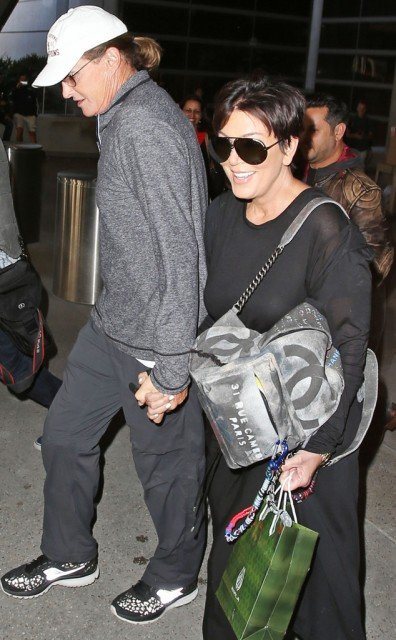 Kris and Bruce Jenner have been spotted holding hands at LAX airport on Wednesday after returning home from Thailand trip