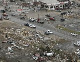 Many homes and businesses, including a new secondary school worth $14 million, were left in ruins in Vilonia after the storm