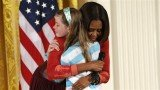 Michelle Obama invited Charlotte Bell on stage and gave her a hug