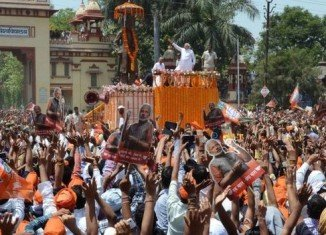 Narendra Modi arrived in the holy city of Varanasi as supporters from BJP poured onto the streets