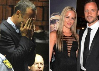 Oscar Pistorius became distraught as he was shown a photo of his dead girlfriend Reeva Steenkamp by the prosecution at his murder trial in Pretoria