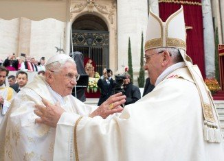 Pope Emeritus Benedict XVI and Pope Francis during Mass before the canonization ceremony of Popes John XXIII and John Paul II
