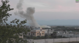 Syria's government and opposition forces have accused each other of using poison gas in an attack on Kafr Zita village on Friday