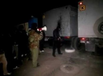 Three people were killed in an overnight raid on a base in Mariupol