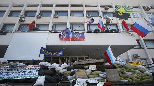 Ukraine's government announces it has regained control of the city hall in the eastern port of Mariupol from pro-Russian separatists