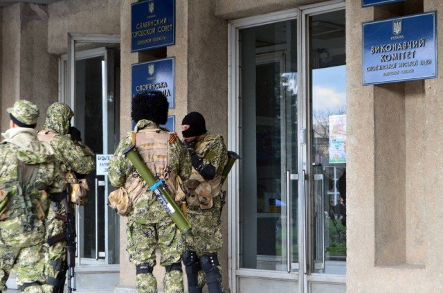 Ukraine has re-launched military operations against pro-Russian militants in the east after two men were found tortured to death