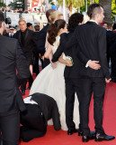 A man was arrested at the Cannes Film Festival after he tried to slip his head under America Ferrera's gown