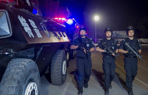 Armed police patrol vehicles have been deployed in Beijing following three attacks at transport hubs around the country