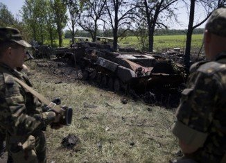 At least 14 soldiers died in a dawn attack on a checkpoint in eastern Ukraine