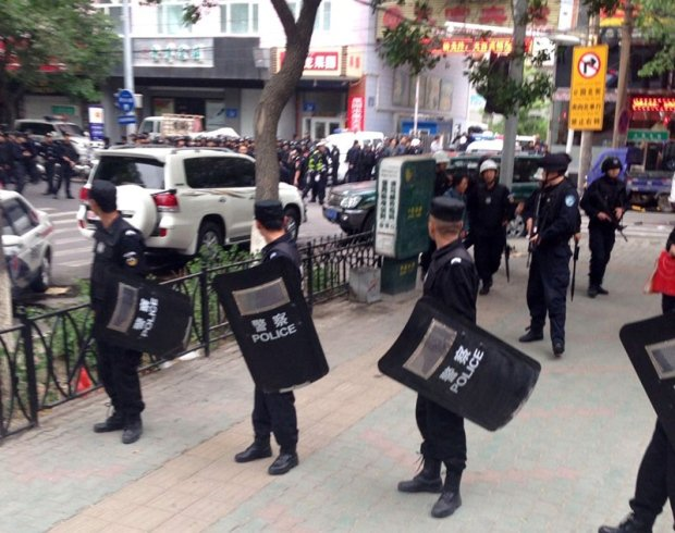 At least 31 people have been killed in Xinjiang region's capital, Urumqi, after attackers crashed two cars into shoppers at a market